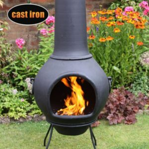 Helios Cast Iron Chiminea - front view in garden