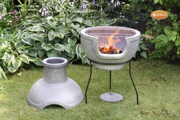 Cozumel BBQ Chiminea with lid removed and fire in garden