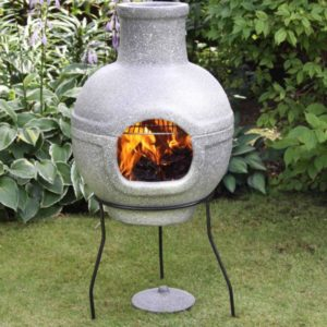 Large Cozumel BBQ Chiminea in granite effect paint in a garden