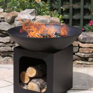 Isla Fire Pit with fire in garden