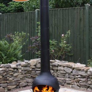Kaska Cast Iron and Steel Chiminea with fire in garden
